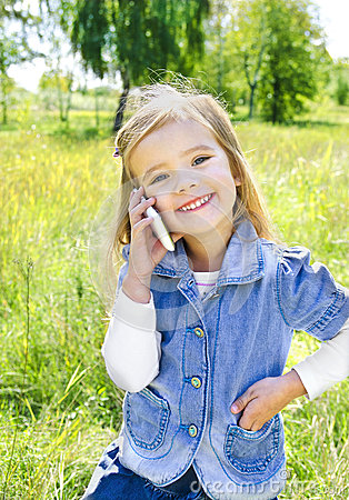 Portrait of cute little girl speaking by phone