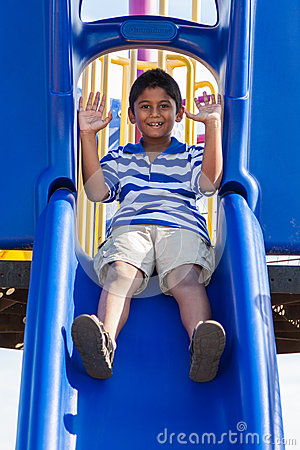Portrait of a cute little indian boy at playground