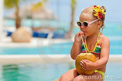Portrait of cute toddler girl with coconut