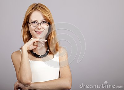 Portrait of cute young redhead business woman