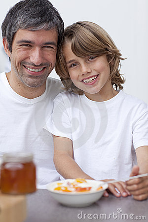 Portrait of dad and son having breakfast together