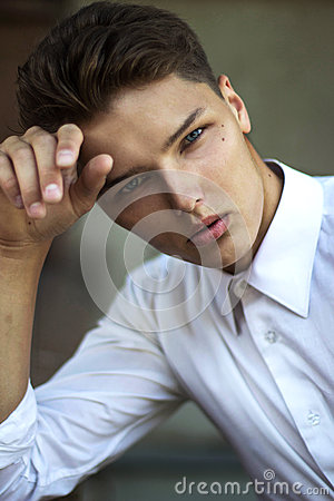 Portrait of Daydreaming Handsome Man Fashion Model in Reverie