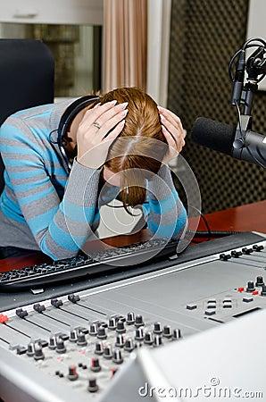 Portrait of depressed female dj