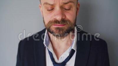Portrait of upset bearded man in untidy formal clothes. The effects of the Covid-19 virus on the economy are. Portrait of desperate bearded man in untidy formal stock footage