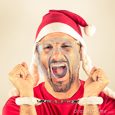 Portrait of a desperate young man with Santa Claus red hat