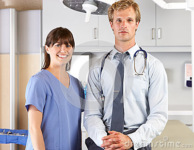 Portrait Of Doctor And Nurse In Doctor s Office