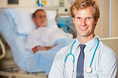 Portrait Of Doctor With Patient In Background