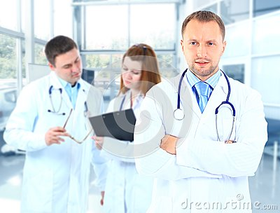 Portrait doctor smiling with colleagues