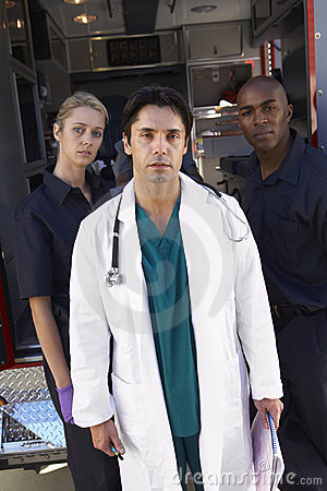 Portrait of doctor with two paramedics