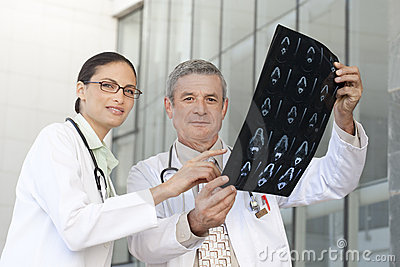 Portrait of doctors looking at xray