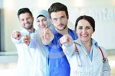 Portrait of doctors team showing thumbs up Stock Photo