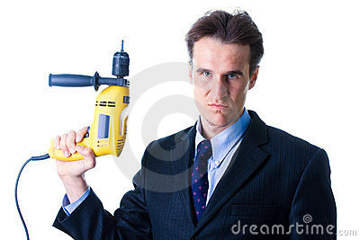 Portrait of dread businessman holding drill