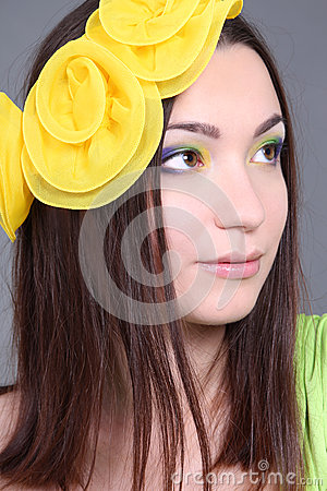 Portrait of dreaming woman with yellow accessory