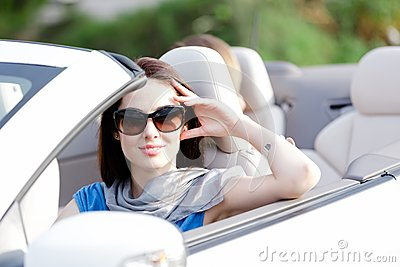 Portrait of dreamy woman in the white car