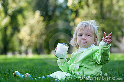 Portrait of a drinking milk in the park
