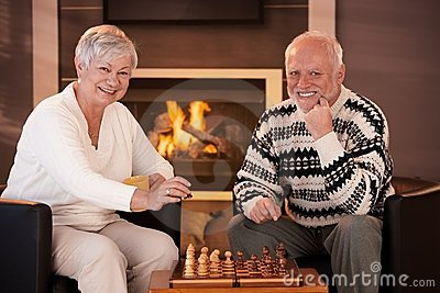 Portrait of elderly couple playing chess