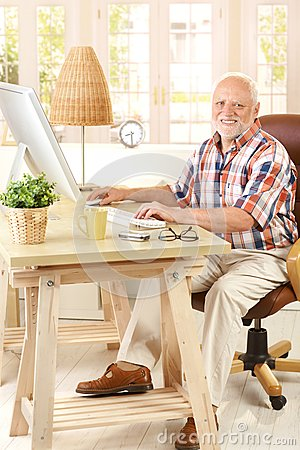 Portrait of elderly man with computer