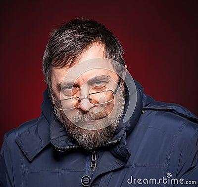 Portrait of elderly man in glasses