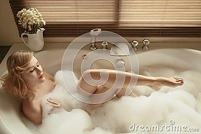 Elegant beautiful woman relaxing in a spa bath