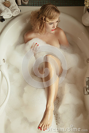 Elegant beautiful woman relaxing in a spa bath
