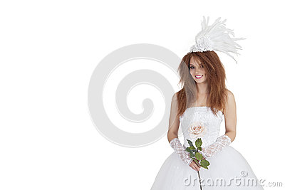 Portrait of elegant brunette in wedding dress holding rose over white background