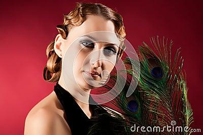 Portrait of elegant woman holding feather