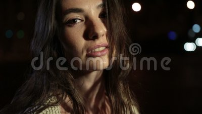 Portrait of elegant woman posing outdoors at night stock footage