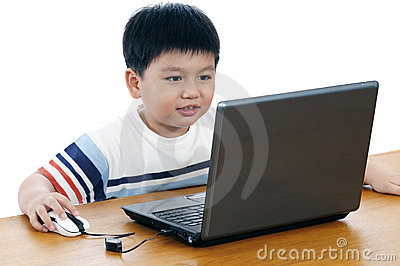 Portrait of an elementary schoolboy with laptop