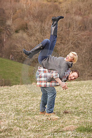 Portrait Of Energetic Young Couple Having Fun