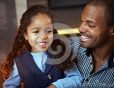 Portrait of ethnic father and cute little daughter