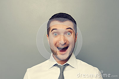 Portrait of excited businessman