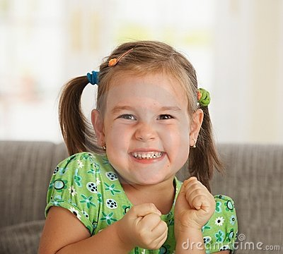 Portrait of excited little girl