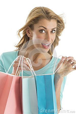Portrait Of Excited Woman Carrying Shopping Bags