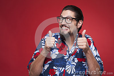 Portrait of an excited young man in Hawaiian shirt gesturing thu