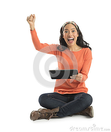 Portrait Of Excited Young Woman Holding Digital Tablet
