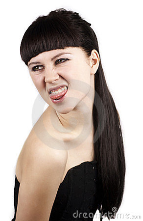 Portrait of expressive woman with her tongue out