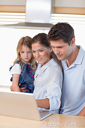 Portrait of a family using a laptop