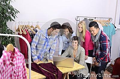 Portrait of fashion designer team at work