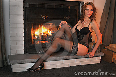 Portrait Fashion model posing in front fireplace