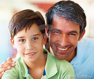 Portrait of a father and son smiling together
