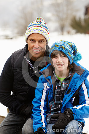 Portrait Of Father And Son Wearing Winter Clothes