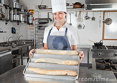 Female Chef Presenting Baked Breads