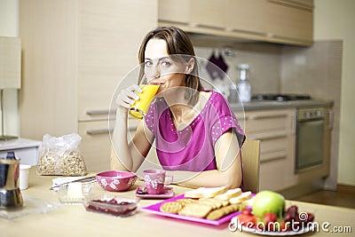Portrait of female model drinking murice