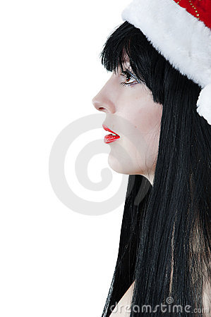 Portrait of female model in red santas hat.