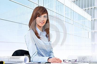 Portrait of female office worker at desk.
