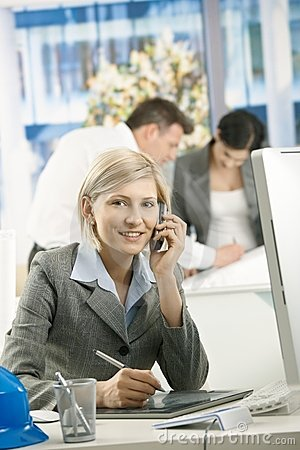 Portrait of female professional on phone