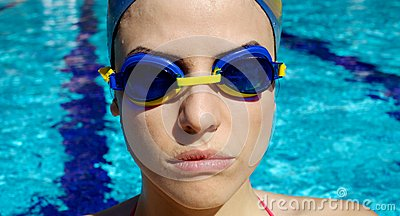 Portrait of female professional swimmer in the water