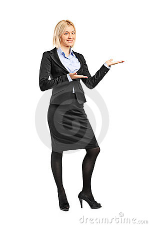 Portrait of a female in suit gesturing welcome