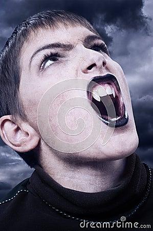 Portrait of fierce vampire with sharp long teeth