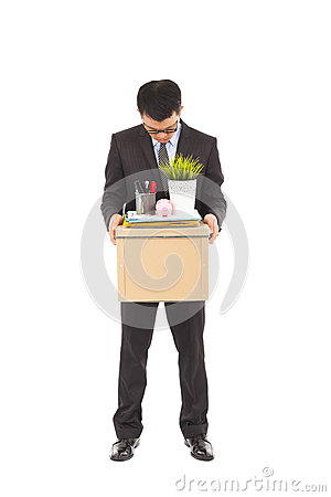 Portrait of a fired businessman carrying a box